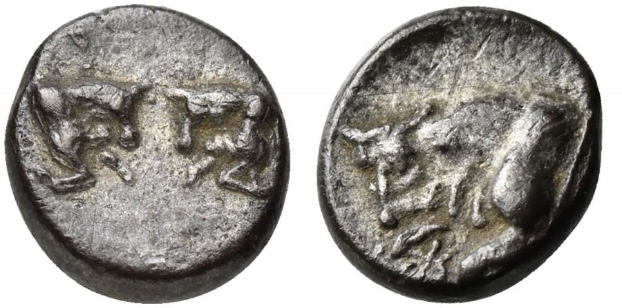Ancient Coins - Caria, Uncertain, AR Hemiobol, ca. 500-450 BC. Confronted foreparts of two bulls R/ Forepart of bull