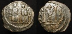 "World Coins - Arab Byzantine. ""Justin and Sophia"" type. Late 7th century AE follis."