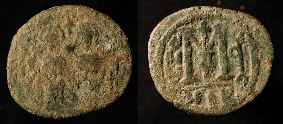 "World Coins - Arab Byzantine. Bronze Fals. Main Bilingual Series : BAISAN, ""MIQSAM"". Foss # 83."