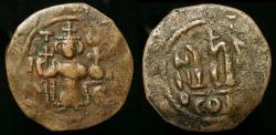 "World Coins - Arab Byzantine. Early Caliphate imitative coinage.  ""ΛITOIЄ"" Type.  Time of the Rashidun.   AE Fals imitating Constans II. Struck circa 647-670."