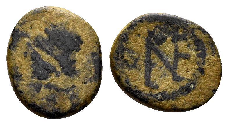 Ancient Coins - Justin I. 518-527. AE Nummus (1,03 gm, 9mm). Constantinople mint. BMC Vandals 135-8