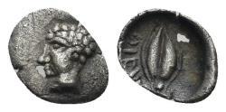 Ancient Coins - Ionia, Magnesia ad Maeandrum. Circa 400-350 BC. AR Tetartemorion (0.13 gm, 8mm). SNG Kayhan 395-6 var.