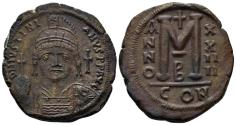 Ancient Coins - Justinian I. 527-565. AE Follis (17.87 gm, 34mm). Constantinople mint, 2nd officina. Dated RY 24 (550/1). SB 163
