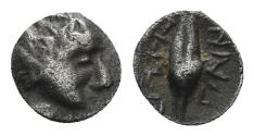 Ancient Coins - Ionia, Magnesia ad Maeandrum. Circa 400-350 BC. AR Tetartemorion (0.19 gm, 5mm). SNG Kayhan 395-6 var.
