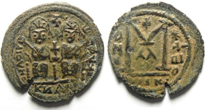 Ancient Coins - Islamic. Umayyad Caliphate. Arab-Byzantine. AE fals. Baysan mint. Struck c. AD 675-694. Very Rare and Probably unpublished!