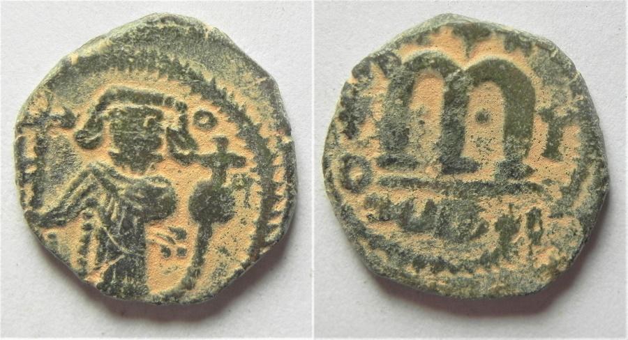 World Coins - ISLAMIC. Umayyad Caliphate. Arab-Byzantine series. AE fals. AL WAFA LELLAH