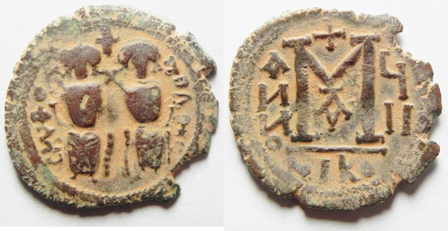 World Coins - ISLAMIC. Ummayad caliphate. Arab-Byzantine series. AE fals (29mm, 6.50G). Baysan (Scythopolis) mint. Struck c. AD 650-700.