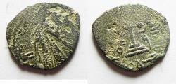 World Coins - ISLAMIC, Umayyad Caliphate. temp. 'Abd al-Malik ibn Marwan. AH 65-86 / AD 685-705. Æ Fals. Standing Caliph type. DAMASCUS mint. Struck circa AH 73-78 (AD 693-697)