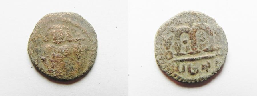 "World Coins - ISLAMIC. Ummayad caliphate. Arab-Byzantine series. AE fals (18MM , 3.84GM ). ""al-Wafa Lillah"" mint. Struck c. AD 650-700."