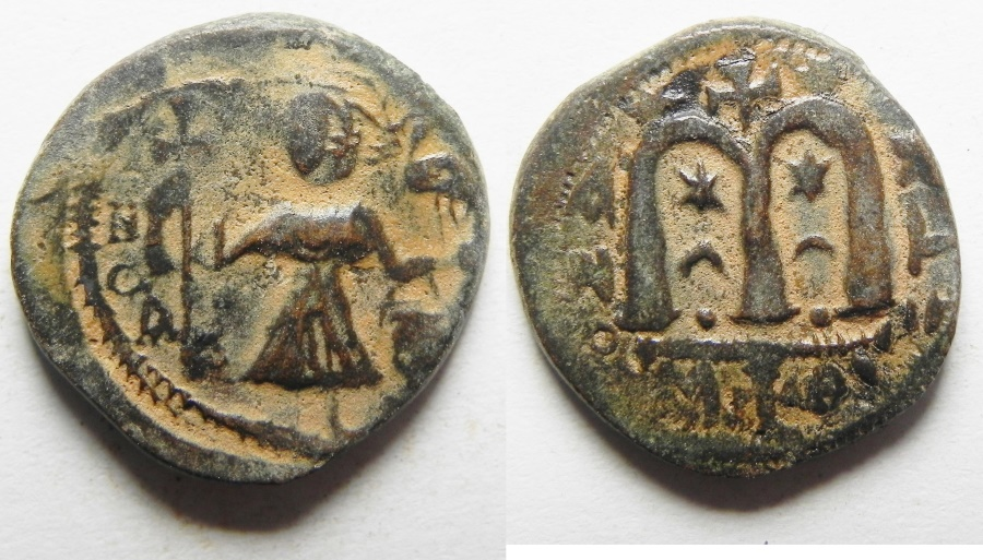 """World Coins - Possibly unpublished variety : ISLAMIC. Ummayad caliphate. Arab-Byzantine series. AE fals (19mm, 4.57g). """"Pseudo-Damascus"""" mint. Struck c. AD 650-700"""