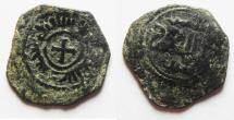 World Coins - MEDIEVAL. Italy. Norman Sicily. Roger II (1130-1154). AE half follaro (15mm, 1.11g). Messina mint. Frozen date AH 53(6).