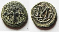 Ancient Coins - ISLAMIC. Umayyad Caliphate. Time of Yazid I ibn Mu'awiya (AH 60-64 / AD 680-683). Arab-Byzantine series. AE fals (21mm, 4.52g). Dimashq mint.