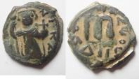"World Coins - ISLAMIC. Ummayad dynasty. Arab-Byzantine series. AE fals (21mm, 4.22g). ""Pseudo-Damascus"" mint. Imitating Constans II types"