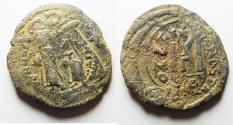 Ancient Coins - BYZANTINE EMPIRE. CONSTANS II OVER STRUCK ON A JUSTINIAN I BRONZE FOLLIS