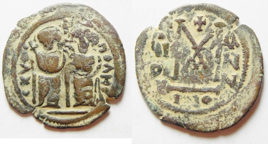 World Coins - ISLAMIC. Ummayad dynasty. Arab-Byzantine series. AE fals (28mm, 5.50g). Scythopolis (Baysan) mint. Struck AD 650-700.