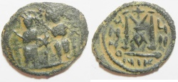 Ancient Coins - ISLAMIC. Umayyad Caliphate. Pre-Reform period (AH 41-77 / AD 661-669) AE fals (29mm, 9.96g). Arab-Byzantine series. Scythopolis (Beysan) mint.