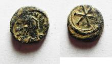 Ancient Coins - CHOICE QUALITY: BYZANTINE. Justinian I (AD 527-565). AE nummus (9mm, 1.03g). Carthage mint.