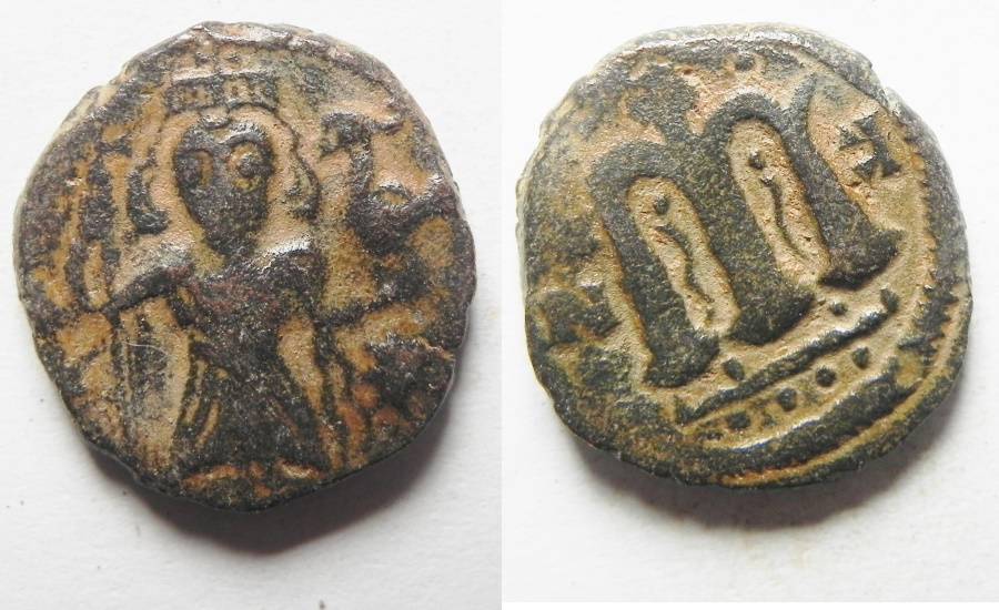 "World Coins - ISLAMIC. Ummayad caliphate. Arab-Byzantine series. AE fals (18mm, 3.72g). ""Pseudo-Damascus"" mint. Struck c. AD 650-700."