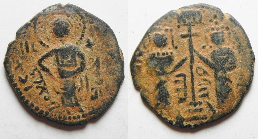World Coins - ISLAMIC. Zengid Atabegs of Aleppo. Nur al-Din Mahmud b. Zengi (AH 541-569/ AD 1146-1174) AE fals (23mm, 3.91g). Halab mint