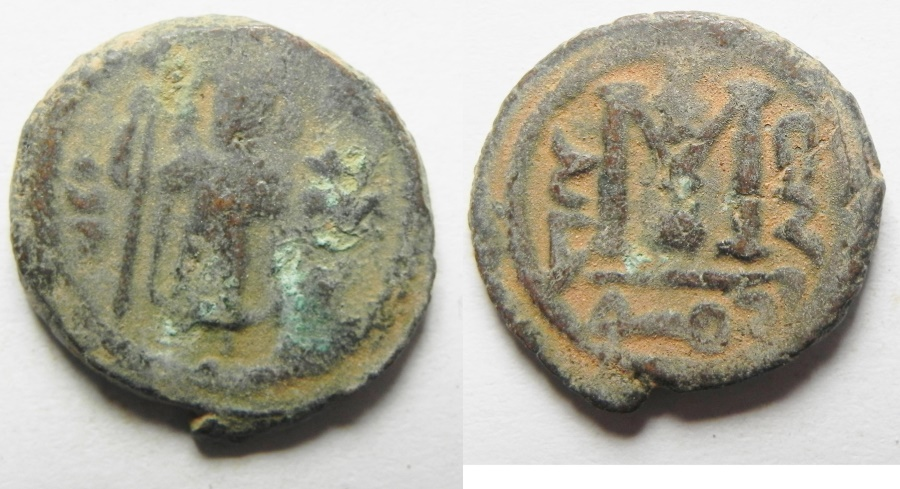 "World Coins - WITH ""KHALED"" : ISLAMIC. Ummayad caliphate. Arab-Byzantine series. AE fals (20mm, 5.10g). ""Pseudo-Damascus"" mint. Struck c. AD 650-700"