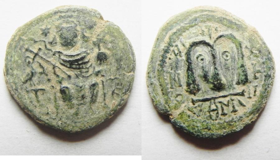 World Coins - ISLAMIC. Umayyad caliphate. Arab-Byzantine series. AE fals (19mm, 3.29g). Dimashq mint. Imitating Junstinian I typres