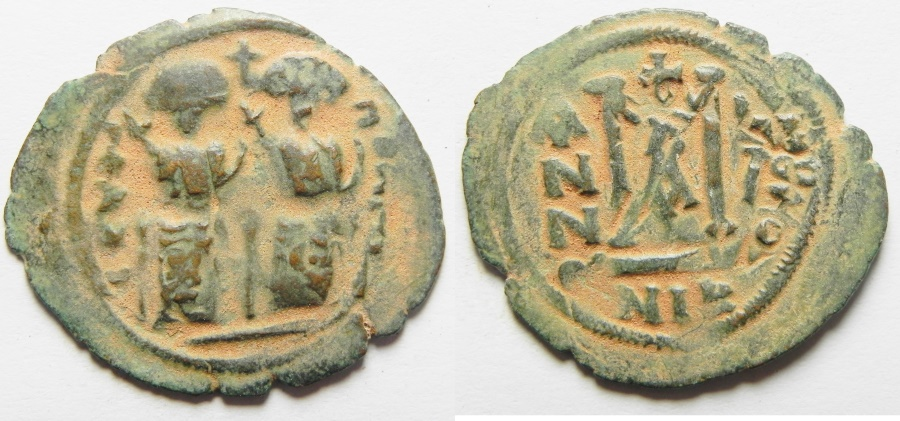 World Coins - ISLAMIC. Ummayad caliphate. Arab-Byzantine series. AE fals (30mm, 4.27g). Baysan (Scythopolis) mint. Struck c. AD 650-700.