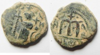 "Ancient Coins - ISLAMIC. Ummayad caliphate. Arab-Byzantine series. AE fals (20mm, 4.47g). ""al-Wafa Lillah"" mint. Struck c. AD 650-700"