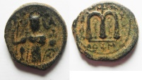 Ancient Coins - ISLAMIC. Ummayad caliphate. Arab-Byzantine series (c. AD 650-700). AE fals (19mm, 5.28g). Dimashq mint.