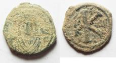 Ancient Coins - AS FOUND. BYZANTINE. MAURICE TIBERIUS AE HALF FOLLIS