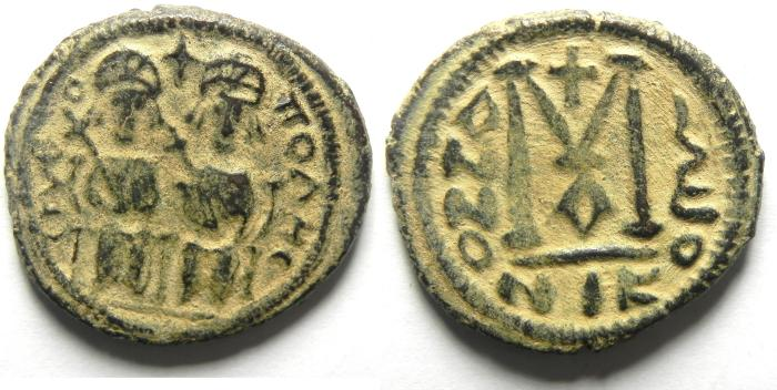 Ancient Coins - Islamic. Umayyad Caliphate. Arab-Byzantine. AE fals. Baysan mint. Struck c. AD 675-694. Very Rare with LELLAH - for god in Arabic
