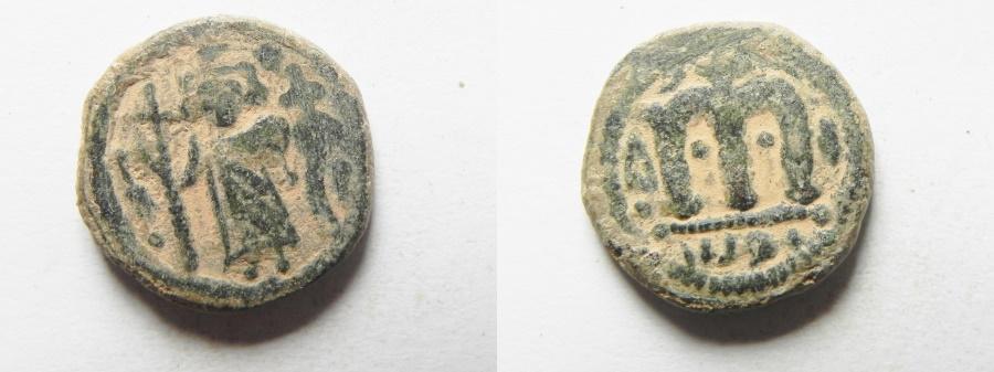 "World Coins - ISLAMIC. Ummayad caliphate. Arab-Byzantine series. AE fals (17mm, 4.00g). ""al-Wafa Lillah"" mint. Struck c. AD 650-700."
