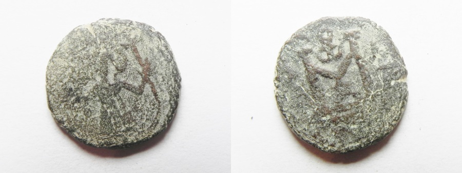 World Coins - ISLAMIC. Ummayad caliphate. Arab-Byzantine series. AE fals (18mm, 3.96g).  Struck c. AD 650-700.