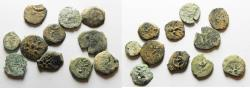 Ancient Coins - AS FOUND. IN IT'S ORIGINAL STATE: LOT OF 11 JUDAEAN BRONZE COINS