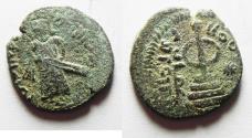World Coins - ISLAMIC, Umayyad Caliphate. temp. 'Abd al-Malik ibn Marwan. AH 65-86 / AD 685-705. Æ Fals. Standing Caliph type. Amman mint. Struck circa AH 73-78 (AD 693-697)