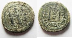 World Coins - ORIGINAL DESERT PATINA: ISLAMIC, Umayyad Caliphate. temp. Mu'awiya I ibn Abi Sufyan. AH 41-60 / AD 661-680. Æ Fals