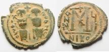 Ancient Coins - ISLAMIC. Ummayad caliphate. Arab-Byzantine series. AE fals (28mm, 6.36g). Baysan (Scythopolis) mint. Struck c. AD 650-700.