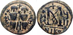 Ancient Coins - EARLY ISLAMIC, Arab-Byzantine. In the style of Justin II. After 641 AD.