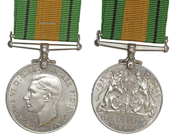 World Coins - Great Britain. George VI. Royal Arms. War World II Defense Medal. UNC