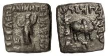 Ancient Coins - BAKTRIA, Indo-Greek Kingdom. Philoxenos. AE hemiobol, circa 125-110 BC. Tyche / Humped bull
