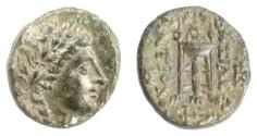 Ancient Coins - SELEUKID KINGS, Antiochos II Theos. AE denomination B/C, Sardeis mint. Apollo / tripod