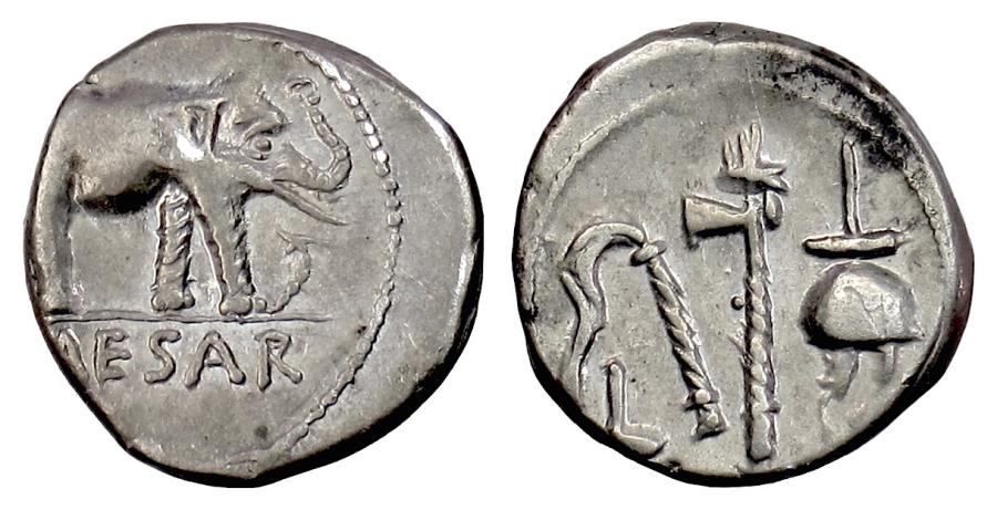 Ancient Coins - Roman Republic, Julius Caesar. AR denarius, Military mint traveling with Caesar.  Elephant trampling serpent