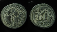 Heraclius and Heraclius Constantine. AE 29 mm Follis, Thessalonica. Overstrucked on Maurice Tiberius, Antioch mint coin.