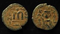 World Coins - ISLAMIC, Umayyad Caliphate (Arab-Byzantine coinage). Circa 685-692. Æ Fals 19mm. Hims (Emesa) mint.