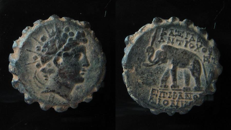 Ancient Coins - Seleukid Kingdom. Antiochos VI Serrated AE 23, 144-141 BC. Antioch.