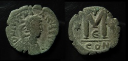 Ancient Coins - Justinian I. AE 30 mm, follis. 527-565 AD, Constantinople. Irregular die with square imitating countermark on obverse.