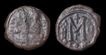 Ancient Coins - Justin II AD 565-578. AE Follis. Mint of Constantinople. Struck in 566/567 AD VF brown patina.