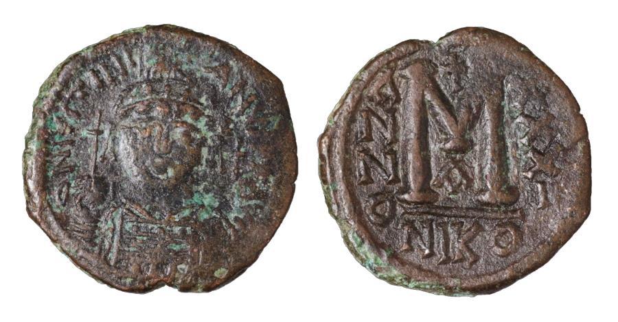Ancient Coins - Justinian I AE Follis Nicomedia mint Struck 556/557 AD aXF Good Struck