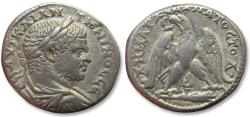 Ancient Coins - AR tetradrachm Caracalla, Tyre (Phoenicia) 213-217 A.D. -- murex shell symbol between legs of eagle--