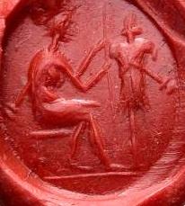 Ancient Coins - Roman intaglio gem. Red carnelian c. 2nd century AD / Seated figure preparing trophy