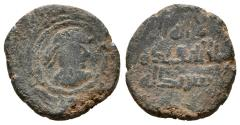 World Coins - SPAIN UNDER THE UMAYYADS. Æ, Fals. AH 80s / AD 700s. Shahada around Warrior's head. SCARCE.